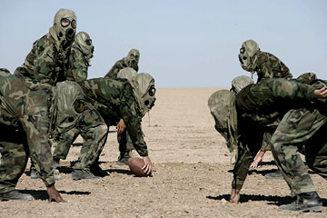Football in the desert in chemical gear